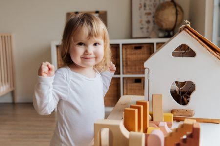 girl-playing-inside-her-room-3933025