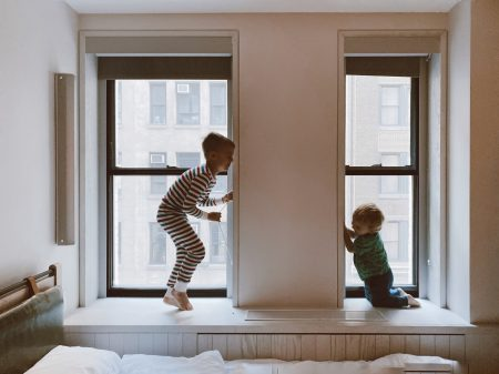 two-kids-playing-beside-glass-windows-3273851