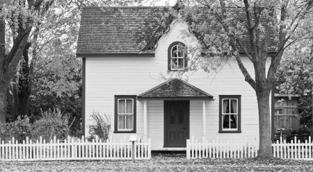 white-and-red-wooden-house-with-fence-1029599-1