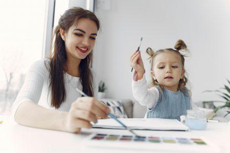 woman-in-white-long-sleeve-shirt-holding-paint-brush-beside-3985008